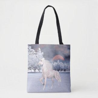 Prancing unicorn in snowy winter sunrise tote bag