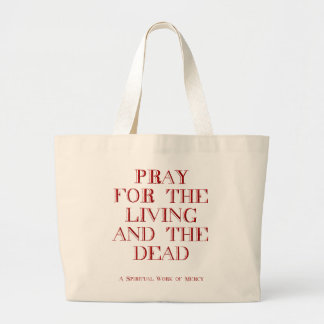 Pray for the living and the dead tote bag