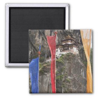 Prayer flags hang near Taktshang 2 Inch Square Magnet