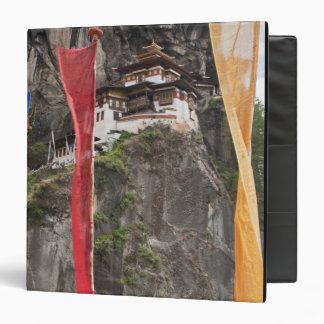 Prayer flags hang near Taktshang Binder