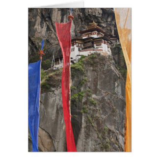Prayer flags hang near Taktshang Card