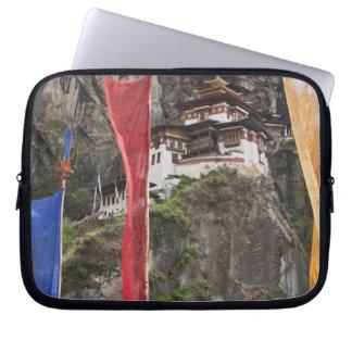 Prayer flags hang near Taktshang Laptop Sleeve