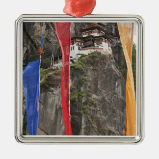 Prayer flags hang near Taktshang Metal Ornament