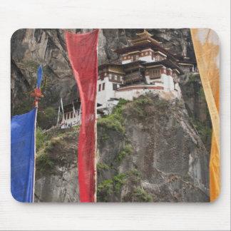 Prayer flags hang near Taktshang Mouse Pads