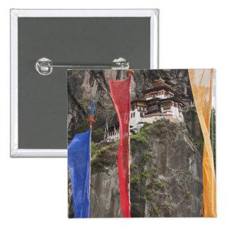 Prayer flags hang near Taktshang Pinback Button