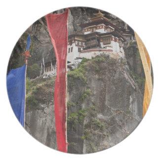 Prayer flags hang near Taktshang Plate