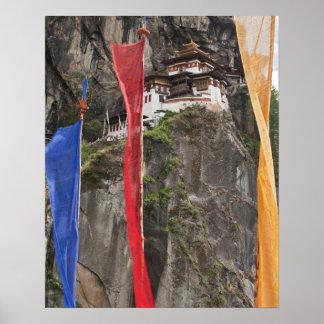 Prayer flags hang near Taktshang Poster
