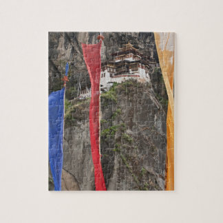 Prayer flags hang near Taktshang Puzzle