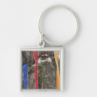Prayer flags hang near Taktshang Silver-Colored Square Keychain