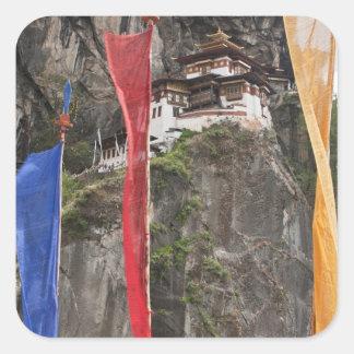Prayer flags hang near Taktshang Square Sticker