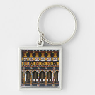 Prayer Wheels in a small public square Keychain