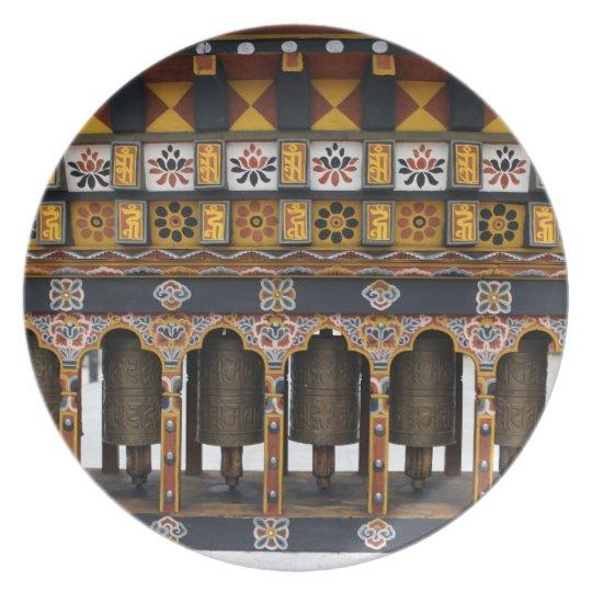 Prayer Wheels in a small public square Plate