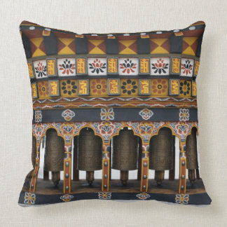 Prayer Wheels in a small public square Throw Pillow