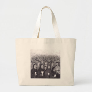 Praying by candle light in Lourdes, France Canvas Bags