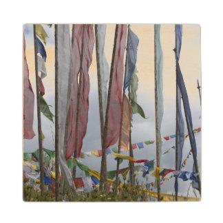 Praying flag poles in mountain, Yotongla Pass Wood Coaster