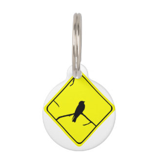Precaución de la silueta del pájaro del trago o placa para mascotas