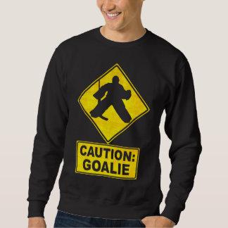 Precaución: Suéter del portero del hockey