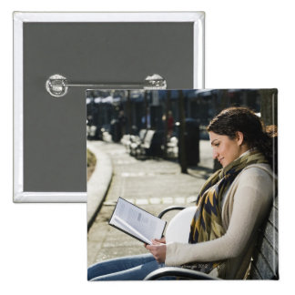 Pregnant Middle Eastern woman reading on park 2 Inch Square Button