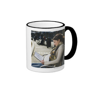 Pregnant Middle Eastern woman reading on park Ringer Coffee Mug