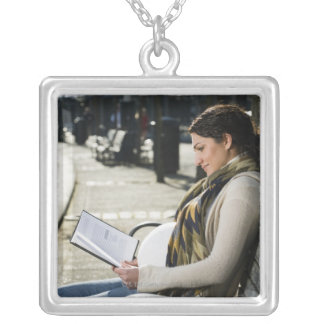 Pregnant Middle Eastern woman reading on park Silver Plated Necklace