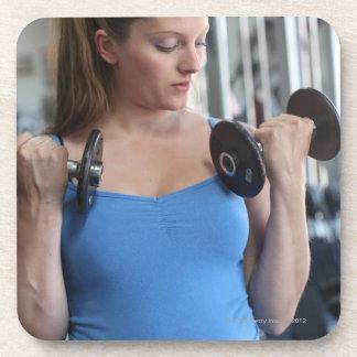 pregnant woman exercising at health club coaster