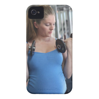 pregnant woman exercising at health club iPhone 4 cover