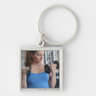 pregnant woman exercising at health club keychain