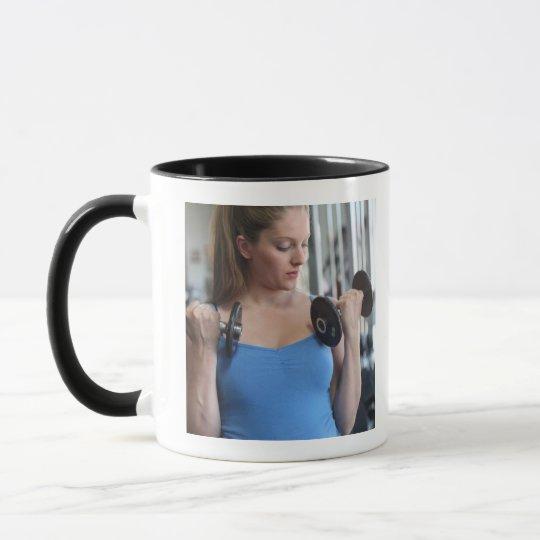 pregnant woman exercising at health club mug