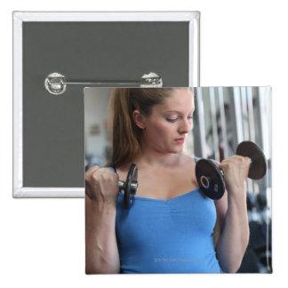 pregnant woman exercising at health club pinback button