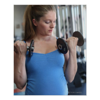 pregnant woman exercising at health club poster
