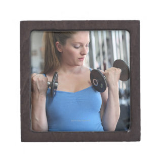 pregnant woman exercising at health club premium jewelry boxes