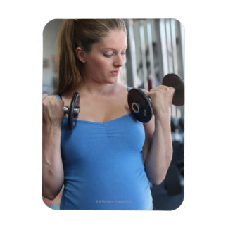 pregnant woman exercising at health club rectangular photo magnet