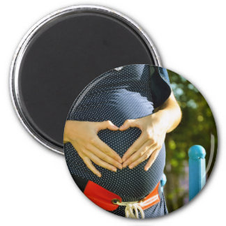 Pregnant woman tummy 2 inch round magnet