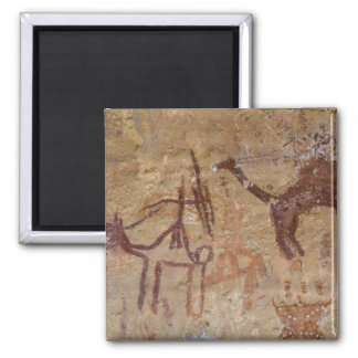 Prehistoric rock paintings with camels and magnet