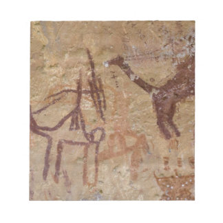 Prehistoric rock paintings with camels and notepad