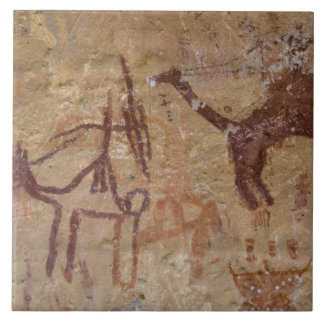 Prehistoric rock paintings with camels and tiles