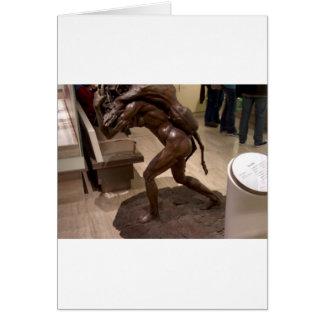 Prehistoric woman carrying an antelope card