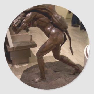 Prehistoric woman carrying an antelope classic round sticker