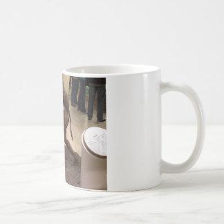 Prehistoric woman carrying an antelope coffee mug