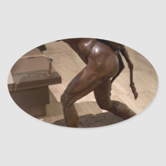 Prehistoric woman carrying an antelope oval sticker