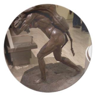 Prehistoric woman carrying an antelope plates