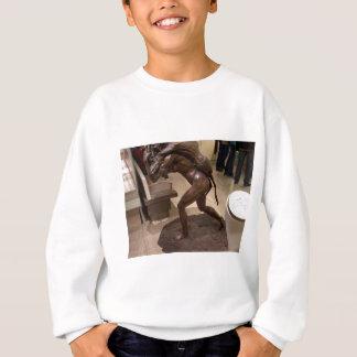 Prehistoric woman carrying an antelope sweatshirt
