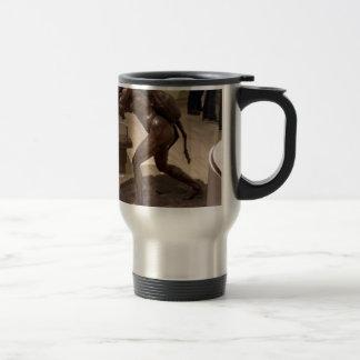 Prehistoric woman carrying an antelope travel mug