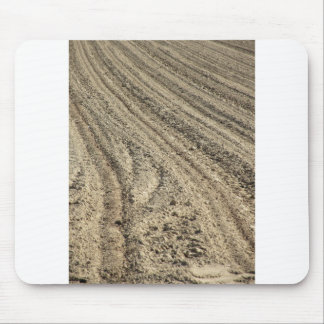 Preparing field for planting. Plowed soil Mouse Pad