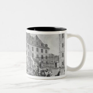 Preparing the shackling of the convicts Two-Tone coffee mug