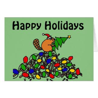 Presa divertida del navidad del castor con las tarjeta de felicitación