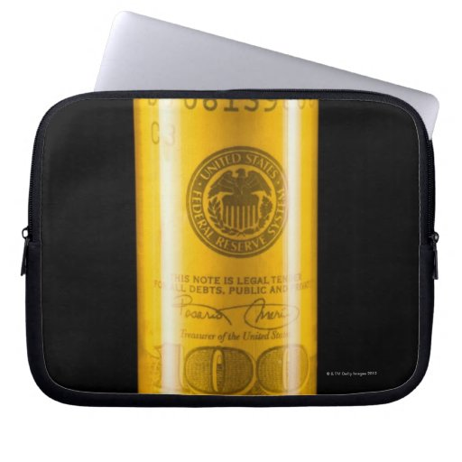 Prescription bottle with one hundred dollar bill computer sleeves