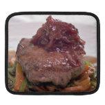 Presentación deliciosa del prendedero de la carne manga de iPad