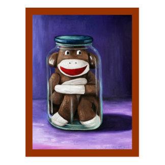 Preservar niñez con el mono del calcetín tarjeta postal