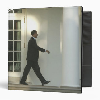 President Barack in deep thought as he walks Binder